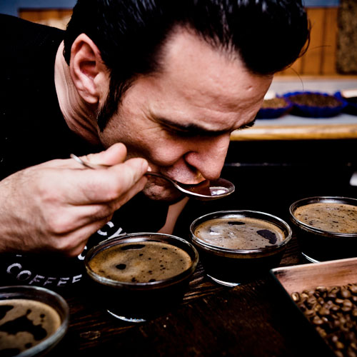 Master Roaster performing a Cupping for Quality Control